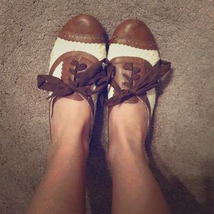 Lace and leather oxford style shoes